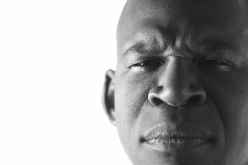 Man Frowning